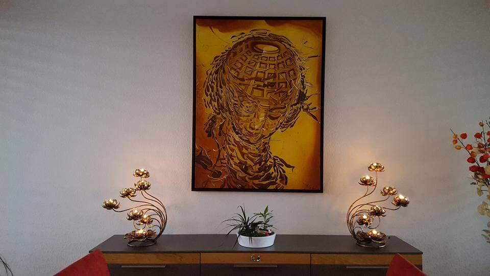Kerzenhalter aus Metall von Wanthai mit sieben Leuchten in Blütenform
